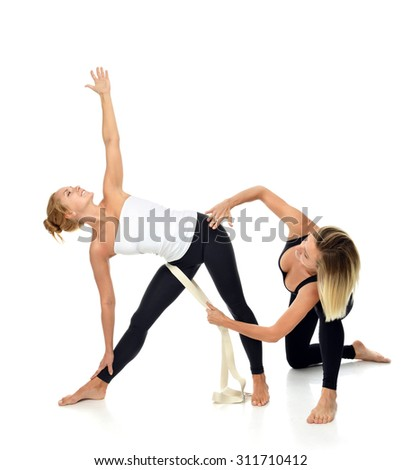 Doctor physiotherapist stretching a young sport woman isolated on a white background