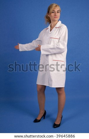 Doctor pointing to her right with both hands - stock photo