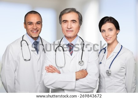 Doctor. Portrait of confident young doctors - stock photo