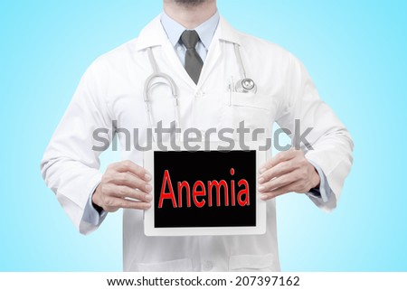 doctor presenting diagnosis Anemia word in digital tablet screen concept for medical  - stock photo