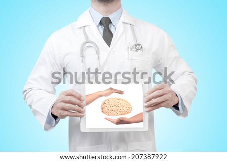doctor presenting diagnosis woman hand protecting brain in digital tablet screen concept for medical for creative thinking - stock photo