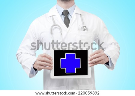 doctor presenting first aid sign in digital tablet screen  - stock photo