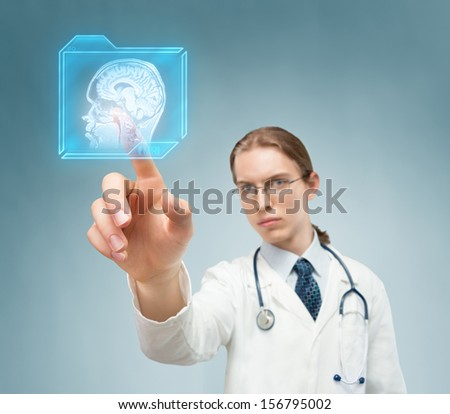 Doctor pushing futuristic button and choosing magnetic resonance of human brain.