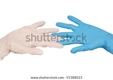 doctor put blue and white sterilized medical glove for making operation - stock photo