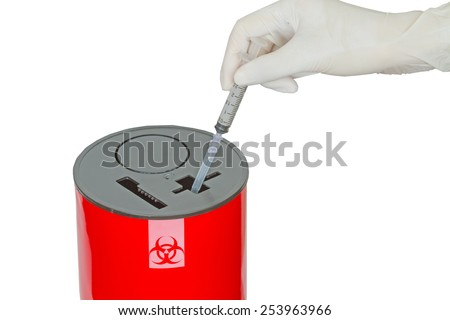 Doctor put syringe in red disposal boxes on white background - stock photo