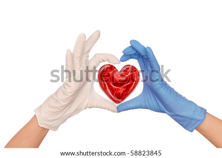 doctor putting on blue and white sterile medical glove for making operation - stock photo
