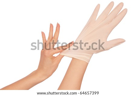 Doctor putting on white sterilized medical glove for making operation