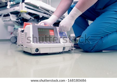Doctor rescues patient in cardiac arrest - stock photo