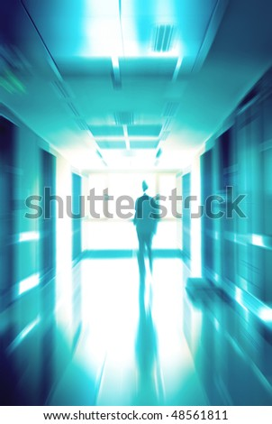 Doctor running at a hospital hall - stock photo