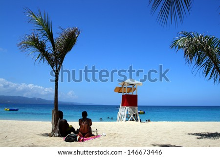 Doctor's Cave Beach Club, Montego Bay (also known as Doctor's Cave Bathing Club) has been one of the most famous beaches in Jamaica for nearly a century.  - stock photo