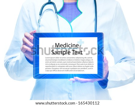 doctor's hands with tablet computer with sample text - stock photo