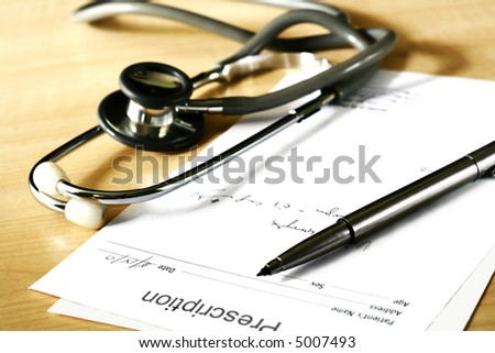 doctor's medical prescription and stethoscope - stock photo