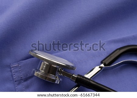 Doctor's stethoscope on scrubs. - stock photo