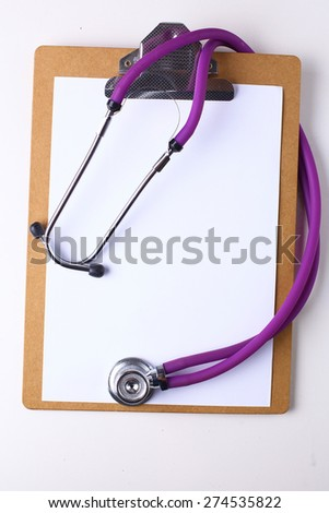 Doctor's stethoscope  with folder on the desk