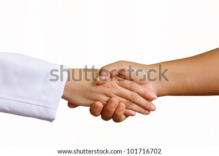 doctor shakes hands with a woman patient with isolated white background - stock photo