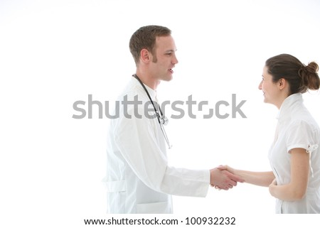 Doctor shaking a colleague's hand in greeting or congratulations at a successful outcome - stock photo