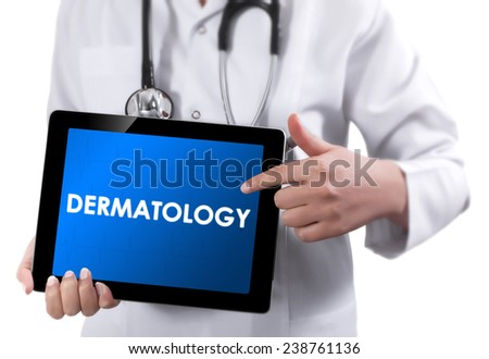 Doctor showing tablet with DERMATOLOGY text.  - stock photo