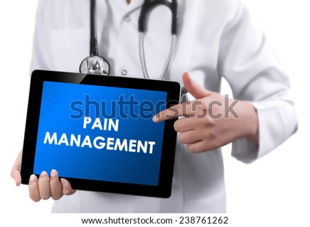 Doctor showing tablet with PAIN MANAGEMENT text.  - stock photo