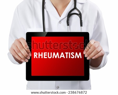 Doctor showing tablet with RHEUMATISM text.  - stock photo