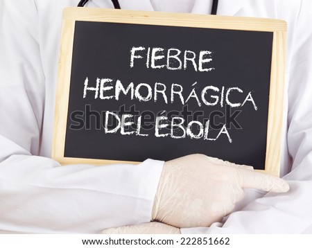 Doctor shows information: Ebola in spanish language