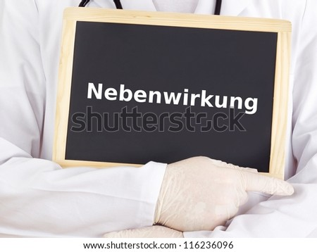Doctor shows information on blackboard: adverse reaction - stock photo