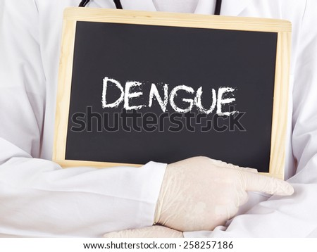 Doctor shows information on blackboard: Dengue - stock photo