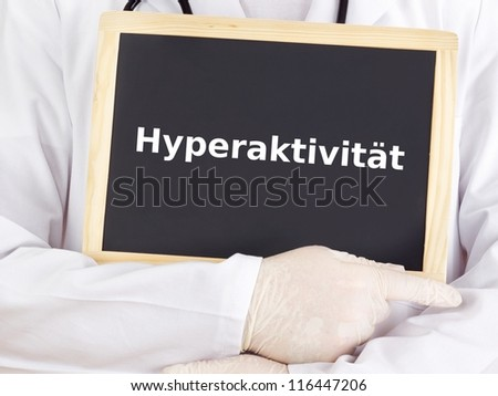 Doctor shows information on blackboard: hyperactivity