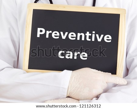 Doctor shows information on blackboard: preventive care - stock photo