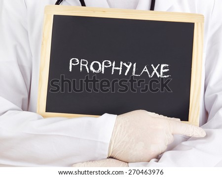Doctor shows information on blackboard: prophylaxis in german - stock photo