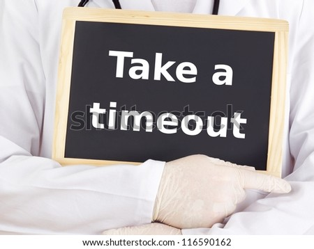 Doctor shows information on blackboard: take a timeout