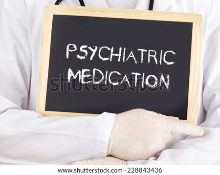 Doctor shows information: psychiatric medication - stock photo