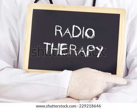 Doctor shows information: radiotherapy - stock photo