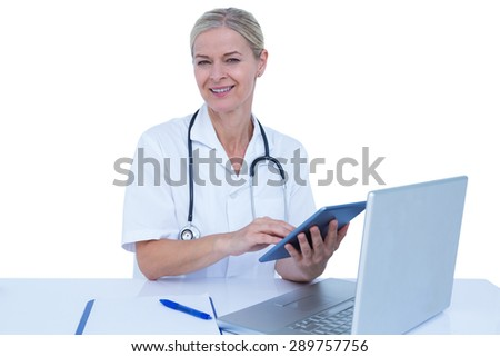 Doctor smiling at the camera on a white background