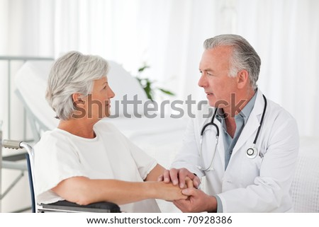 Doctor speaking with his patient - stock photo