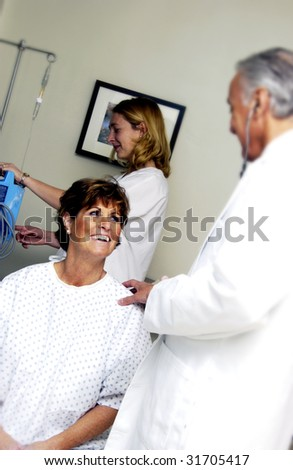 Doctor speaking with patient - stock photo