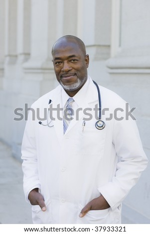 Doctor Standing Outside With Stethoscope Around Neck - stock photo