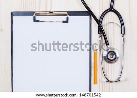 Doctor stethoscope, clipboard with paper blank, pencil