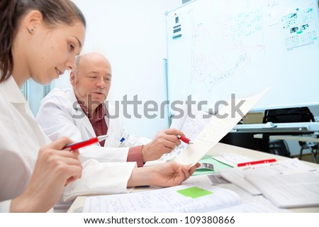 Doctor takes the exam students - stock photo