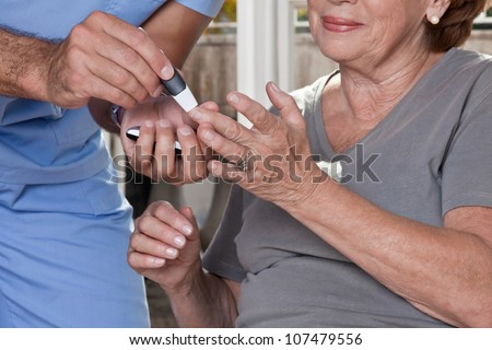 Doctor taking a blood sample from a female patient's. - stock photo