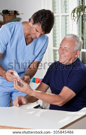 Doctor taking a blood sample from a male patient's. - stock photo