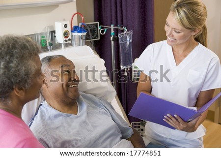 Doctor Talking To Senior Couples,Making Notes - stock photo