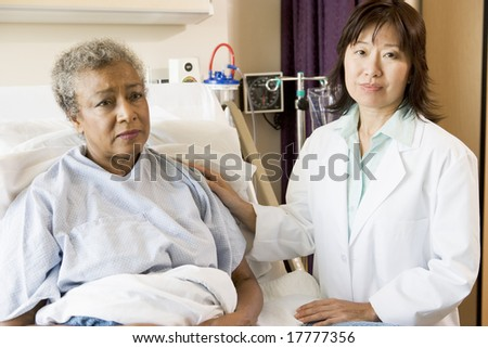 Doctor Talking To Senior Woman - stock photo