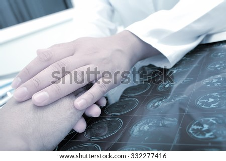 Doctor tells the patient some bad newsn hospital - stock photo