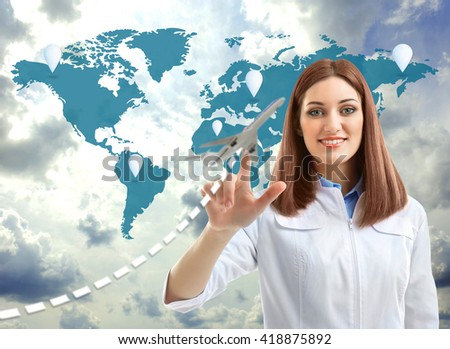 Doctor touching plane icon on virtual screen. Medical tourism concept - stock photo