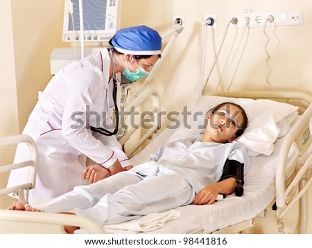Doctor treats female patient with stethoscope. Medicine. - stock photo