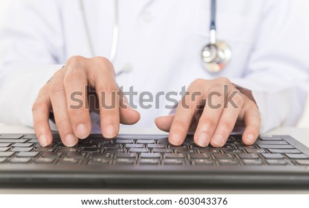 Doctor use keyboard to report diagnosis of patient