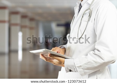 Doctor using a digital tablet - stock photo