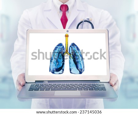 Doctor vith lungs in hands in a hospital - stock photo