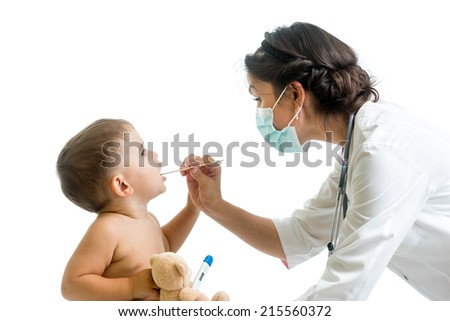 doctor weared protective mask examining kid boy - stock photo