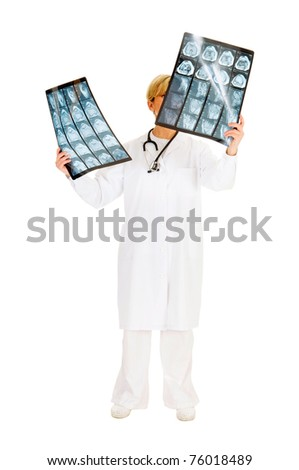 doctor who examines an x-ray NMR - stock photo
